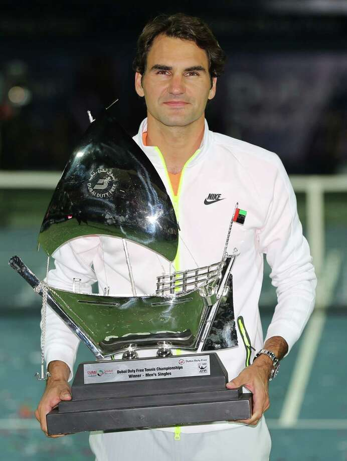 Roger Federer of Switzerland holds the trophy after defeating Novak Djokovic of Serbia in the final match of the Dubai Duty Free Tennis Championships in Dubai, United Arab Emirates, Saturday, Feb. 28, 2015. (AP Photo/Kamran Jebreili) ORG XMIT: XKJ102 Photo: Kamran Jebreili / AP