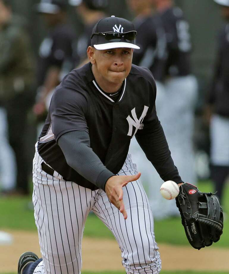 New York Yankees' Alex Rodriguez tosses the ball to a pitcher while fielding ground balls at first base during workouts Friday, Feb. 27, 2015, in Tampa, Fla. Rodriguez was working out at first base for the first time this spring. (AP Photo/Chris O'Meara)  ORG XMIT: FLCO106 Photo: Chris O'Meara / AP