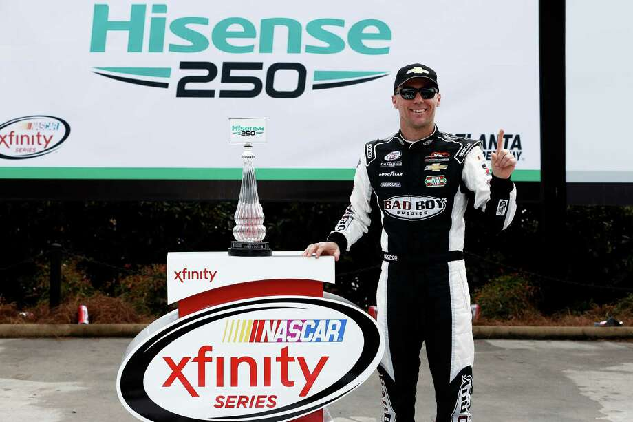 HAMPTON, GA - FEBRUARY 28: Kevin Harvick, driver of the #88 Bad Boy Buggies Chevrolet, poses in victory lane after winning the NASCAR XFINITY Series Hisense 250 at Atlanta Motor Speedway on February 28, 2015 in Hampton, Georgia.  (Photo by Jeff Zelevansky/Getty Images) ORG XMIT: 540054395 Photo: Jeff Zelevansky / 2015 Getty Images
