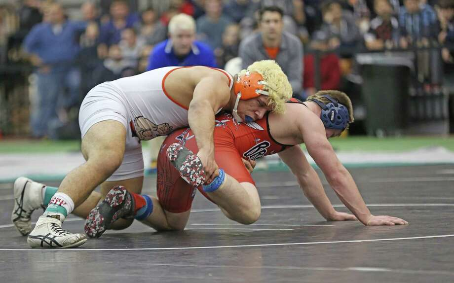 Danbury High School's Juan Johnny Garcia works his 182 lb class opponent Dakota Carden of Branford High School during Saturday evening State Open Championships held at Floyd Little Athletic Center in New Haven. Garcia would win the match. Photo: Mike Ross / Mike Ross Connecticut Post freelance -www.mikerossphoto.com