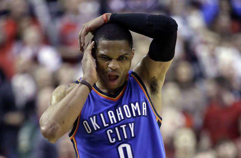 Oklahoma City Thunder guard Russell Westbrook walks down court with only seconds to go during the second half of an NBA basketball game against the Portland Trail Blazers in Portland, Ore., Friday, Feb. 27, 2015. Westbrook scored 40 points but missed an opportunity to tie the game, making only two of three free throws with just seconds left. Portland won 115-112. (AP Photo/Don Ryan) Photo: Don Ryan, STF / Associated Press / AP