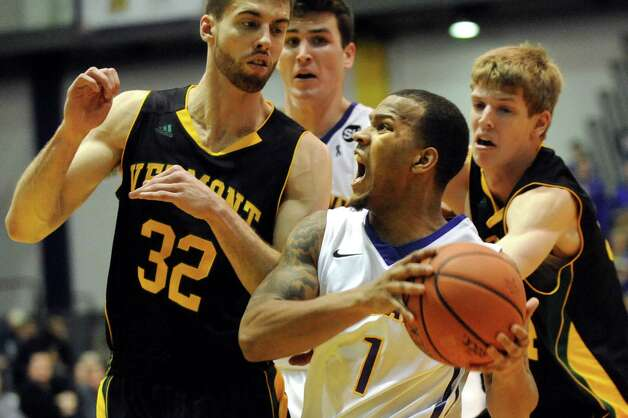 UAlbany's Ray Sanders, right, works the court as Vermont's Ethan O'Day defends during their basketball game on Saturday, Feb. 28, 2015, at UAlbany in Albany, N.Y. (Cindy Schultz / Times Union) Photo: Cindy Schultz / 00030743A
