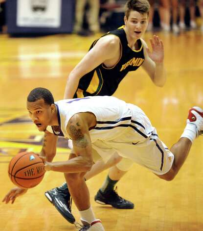 UAlbany's Ray Sanders, left, picks up a loose ball past Vermont's Zach McRoberts during their basketball game on Saturday, Feb. 28, 2015, at UAlbany in Albany, N.Y. (Cindy Schultz / Times Union) Photo: Cindy Schultz / 00030743A