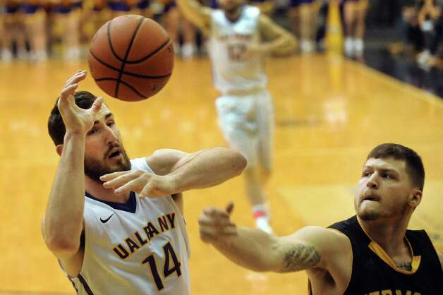 UAlbany's Sam Rowley, left, looses a rebound when Vermont's Brandon Hatton knocks it away during their basketball game on Saturday, Feb. 28, 2015, at UAlbany in Albany, N.Y. (Cindy Schultz / Times Union) Photo: Cindy Schultz / 00030743A