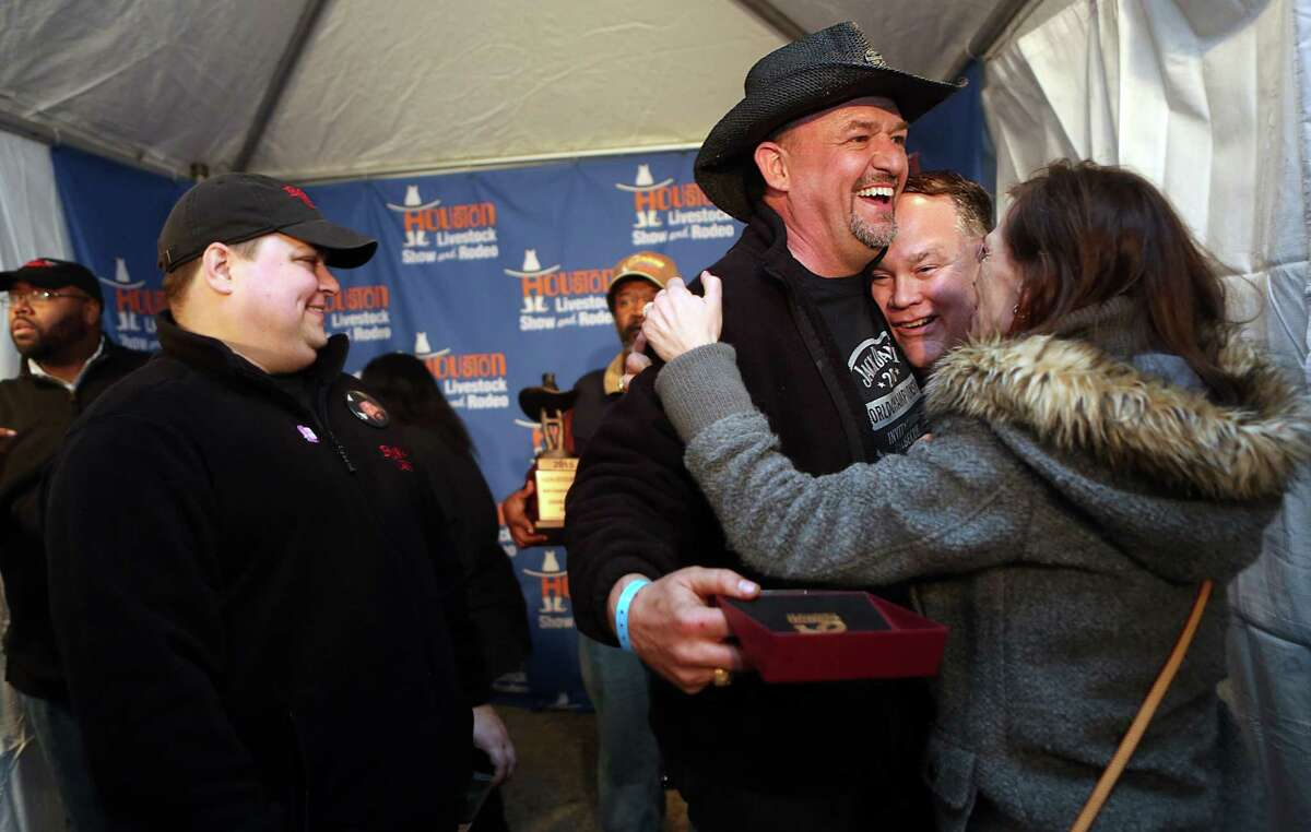 Teammates Doug Scheiding, David Spurlin, Holly Spurlin, and the rest of the 'Across the Track Cook-Off Team' celebrate winning the Grand Champion Overall in the 2015 Houston Livestock Show and Rodeo World's Champion Bar-B-Que Cookoff on Saturday, Feb. 28, 2015, in Houston.