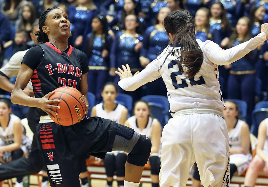 Thunderbird guard Kiana Williams angles around Amber Vidal for a layup as Wagner beats O'Connor 55-40 to win the Region IV-6A girls basketball final at the UTSA Convocation Center on Feb. 28, 2015. Photo: Tom Reel /San Antonio Express-News / San Antonio Express-News