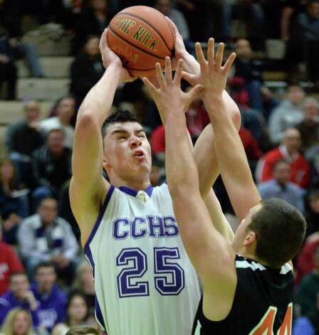 CCHS' #25 Anthony Mack makes this shot as Bethlehem's #44 Justin LaClair covers during the Class AA quarterfinal Saturday Feb. 28, 2015 in Troy, NY.  (John Carl D'Annibale / Times Union) Photo: John Carl D'Annibale / 00030782A