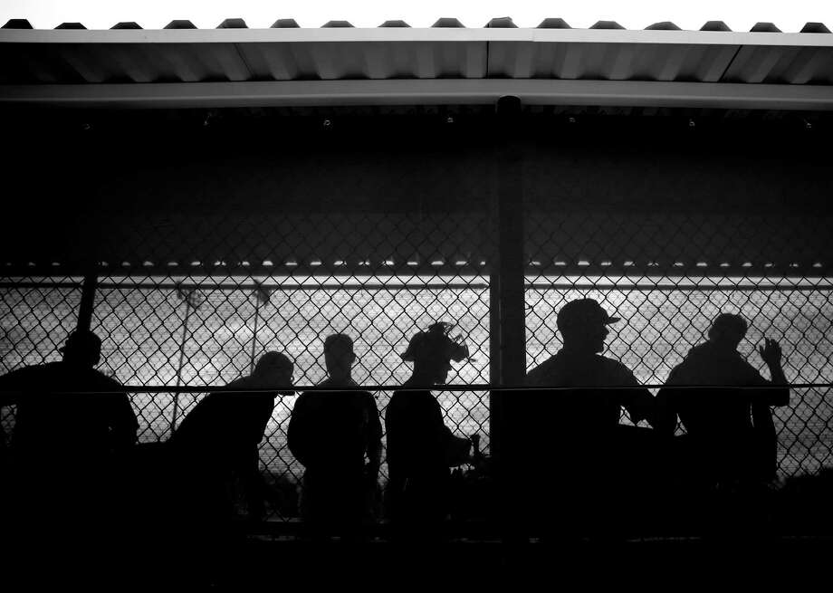 Members of the Oakland A's gather their equipment at the end of the first intrasquad game of Spring Training at Fitch Park in Mesa, Arizona, on Saturday, February 28, 2015. Photo: Scott Strazzante / The Chronicle / ONLINE_YES