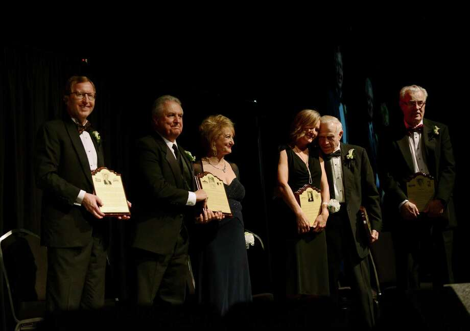 The members of the Class of 2015 of the San Antonio Sports Hall of Fame, from left, Pat Frost, Mike LaMacchia and Rozana Corbo, who are the children of inductee Al LaMacchia, Lori Norwood, Gary DeLaune and Doug Moe stand onstage at the Henry B. Gonzalez Convention Center on Saturday, Feb. 28, 2015. Photo: Billy Calzada, Staff / San Antonio Express-News / San Antonio Express-News