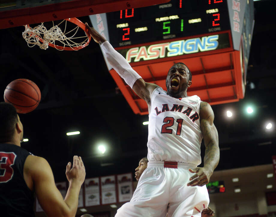Lamar's Donovan Ross, No. 21, reacts as he makes dunk during Saturday's game against Incarnate Word. The Lamar Cardinals hosted the Incarnate Word Cardinals at the Montagne Center on Saturday night. Photo taken Saturday 2/28/15 Jake Daniels/The Enterprise Photo: Jake Daniels / ©2014 The Beaumont Enterprise/Jake Daniels