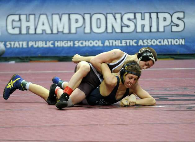 Schuylerville's Orion Anderson defeated Jack Bokina of Mattituck in their 99lb. semi-final during the 2015 State Wrestling Tournament at the Times Union Center on Saturday Feb. 28, 2015 in Albany, N.Y. (Michael P. Farrell/Times Union) Photo: Michael P. Farrell / 00030781B