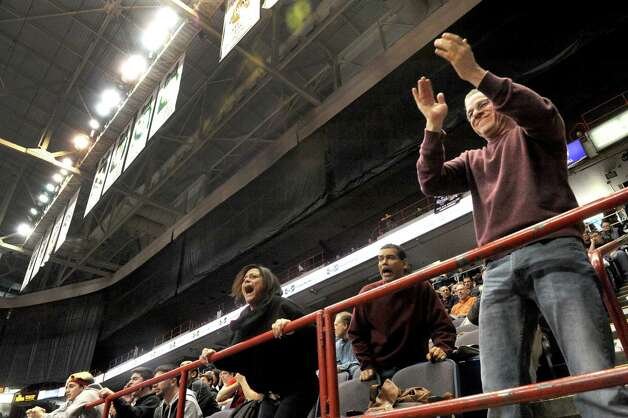 Wrestling fans take in the semi-final matches during the 2015 State Wrestling Tournament at the Times Union Center on Saturday Feb. 28, 2015 in Albany, N.Y. (Michael P. Farrell/Times Union) Photo: Michael P. Farrell / 00030781B