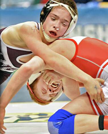 Orion Anderson, top, of Schuylerville wrestles A.J. Burkhart of Waverly during the State Wrestling Tournament finals at the Times Union Center Saturday Feb. 28, 2015, in Albany, NY.  (John Carl D'Annibale / Times Union) Photo: John Carl D'Annibale / 00030781A