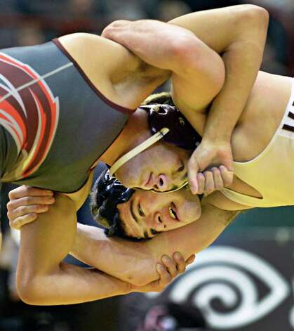 David Hamil, top, of Deer Park wrestlesJake Ashcraft of Burnt Hills during the State Wrestling Tournament 182 lb. final at the Times Union Center Saturday Feb. 28, 2015, in Albany, NY.  (John Carl D'Annibale / Times Union) Photo: John Carl D'Annibale / 00030781A