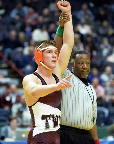 Kevin Parker of Shenendehowa has his hand raised in victory after defeating Nate Schwab of Clarence in the 170 lb. match during the State Wrestling Tournament finals at the Times Union Center Saturday Feb. 28, 2015, in Albany, NY.  (John Carl D'Annibale / Times Union) Photo: John Carl D'Annibale / 00030781A