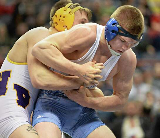 Jason Hoffman, right, of Hadley-Luzerne/Lake George wrestles Alex Herringshaw of Holland Patent in the 160lb. final at the State Wrestling Tournament 182 lb. final at the Times Union Center Saturday Feb. 28, 2015, in Albany, NY.  (John Carl D'Annibale / Times Union) Photo: John Carl D'Annibale / 00030781A