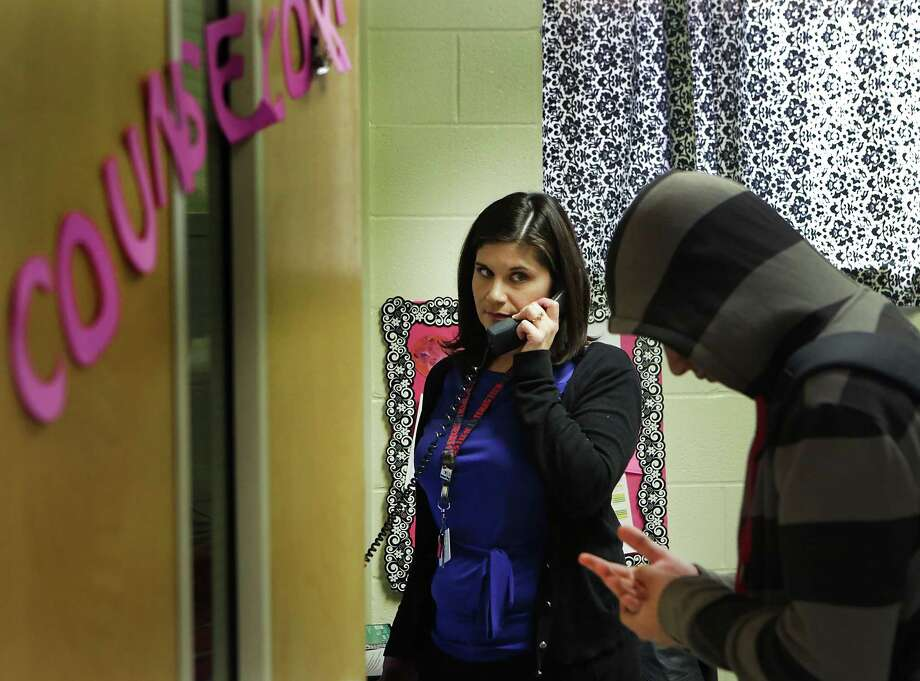 Analisa Perez, Counselor for the nearly 600 students at Alan B. Shepard Middle School in the South San ISD, calls the parent of a student visiting her office.  Friday, Feb. 13, 2015. Photo: BOB OWEN, San Antonio Express-News / © 2015 San Antonio Express-News