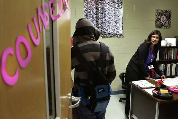 Analisa Perez, Counselor for the nearly 600 students at Alan B. Shepard Middle School in the South San ISD, helps a student visiting her office. Friday, Feb. 13, 2015.