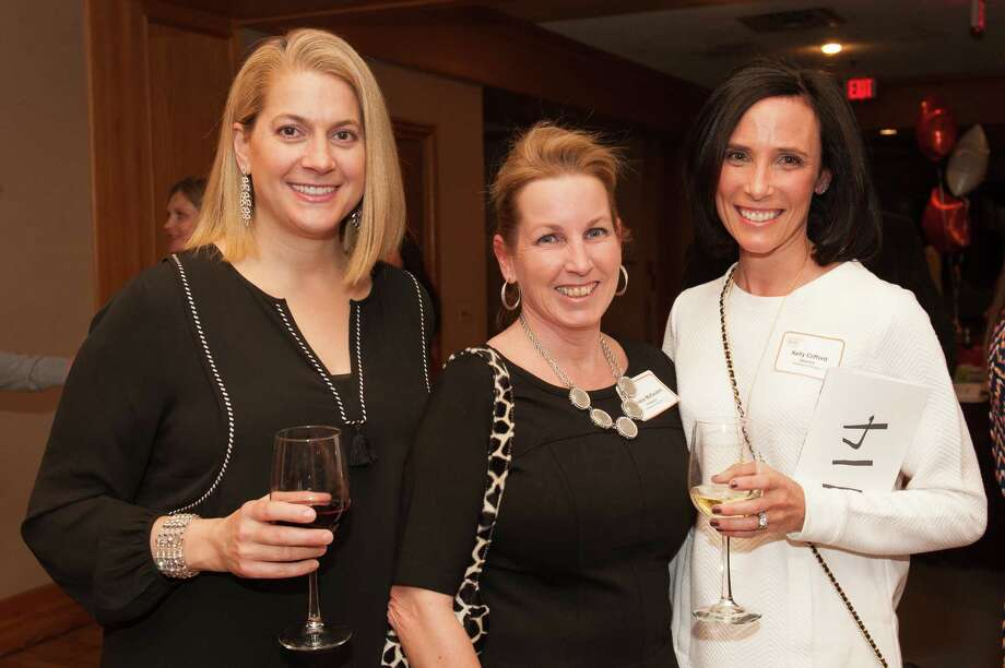 """The YWCA Darien/Norwalk hosted its benefit """"Travel with Taste,"""" on February 28, 2015 at Dolce Hotels and Resorts Norwalk. The event will featured restaurant tastings, live music by Tangled Vine and an auction. Proceeds from the benefit supported YW outreach programs. Were you SEEN? Photo: Meghan Rowe"""