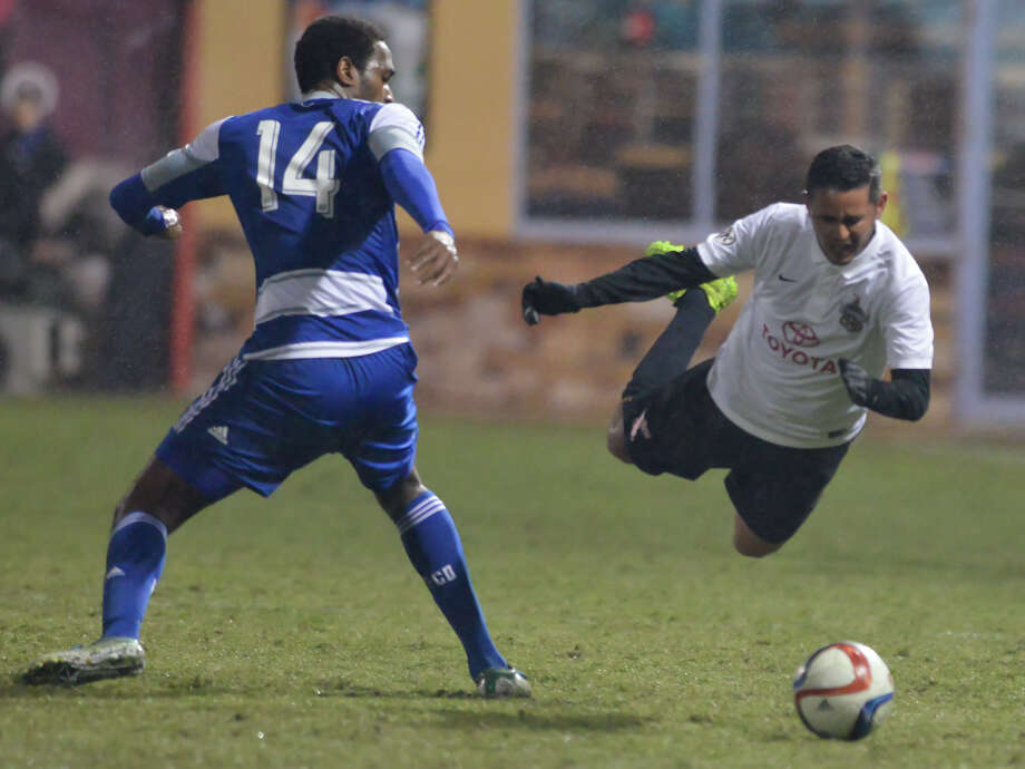 Scorpions midfielder Pablo Cruz goes airborne after being tripped by FC Dallas' Atiba Harris on Feb. 28, 2015, at Toyota Field. Photo: Robin Jerstad /For The Express-News / Robin Jerstad