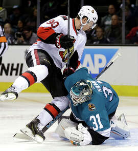 Ottawa's Alex Chiasson collides with Sharks goalie Antti Niemi during the second period at SAP Center.
