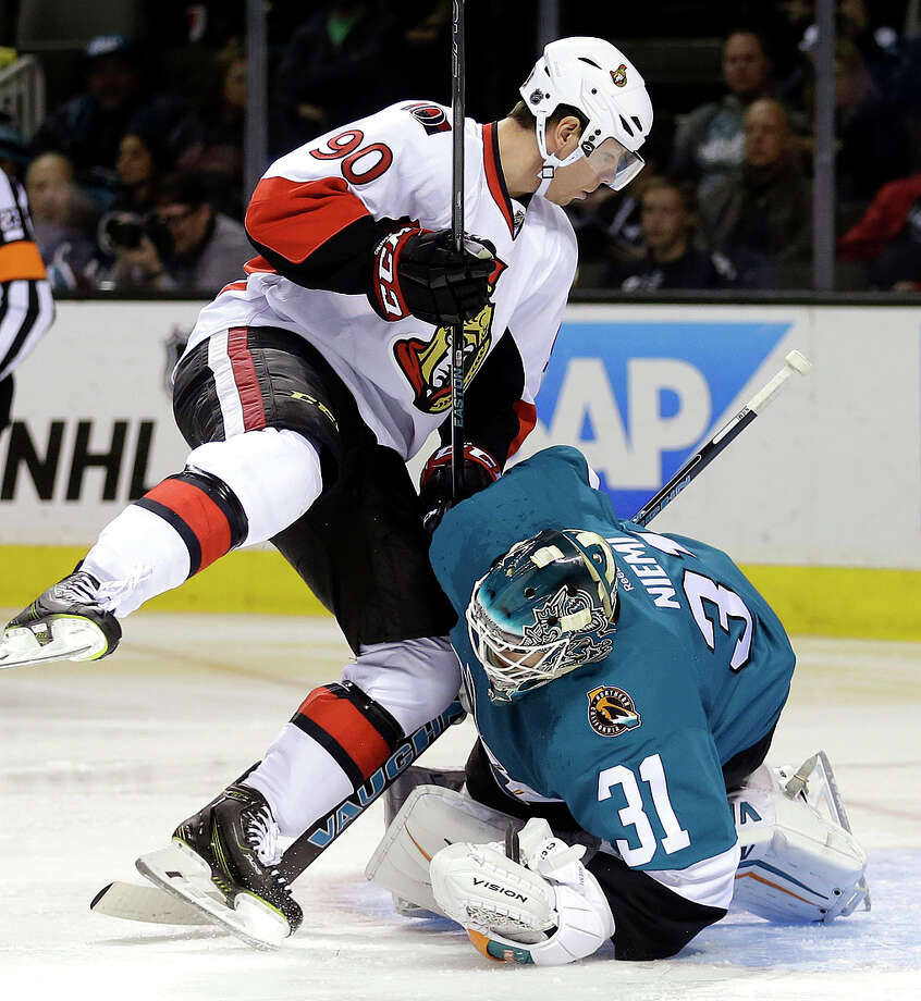 Ottawa's Alex Chiasson collides with Sharks goalie Antti Niemi during the second period at SAP Center. Photo: Ben Margot / Associated Press / AP