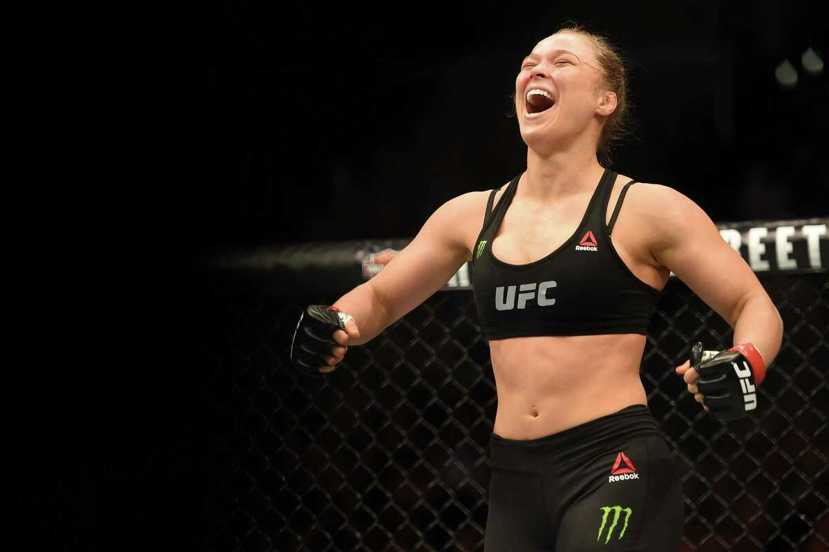 LOS ANGELES, CA - FEBRUARY 28: Ronda Rousey celebrates her victory over Cat Zingano in their UFC women's bantamweight championship bout during the UFC 184 event at Staples Center on February 28, 2015 in Los Angeles, California.
