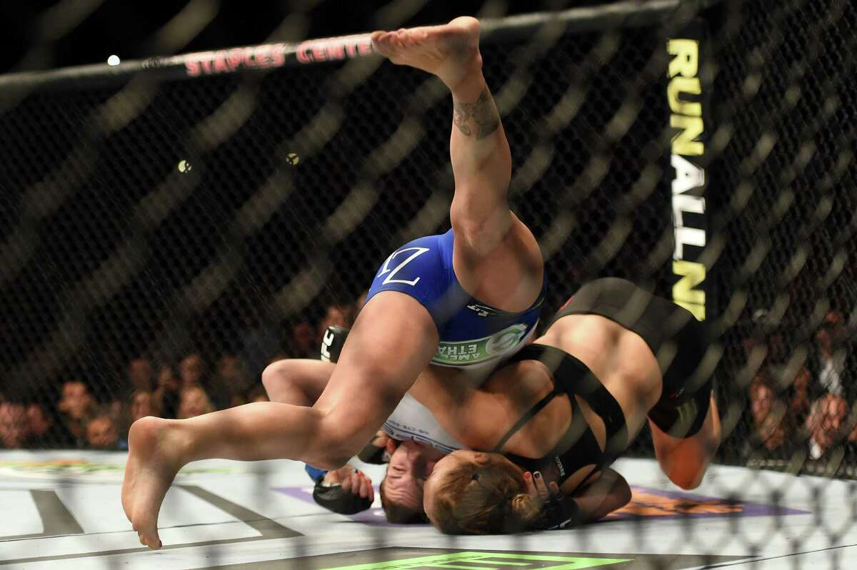LOS ANGELES, CA - FEBRUARY 28: (Blue shorts) Cat Zingano takes down Ronda Rousey in their UFC women's bantamweight championship bout during the UFC 184 event at Staples Center on February 28, 2015 in Los Angeles, California.
