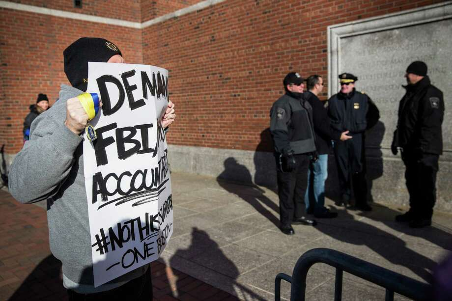 A protester stands outside the federal courthouse in Boston, where jury selection has been underway. Photo: Andrew Burton / Getty Images / 2015 Getty Images