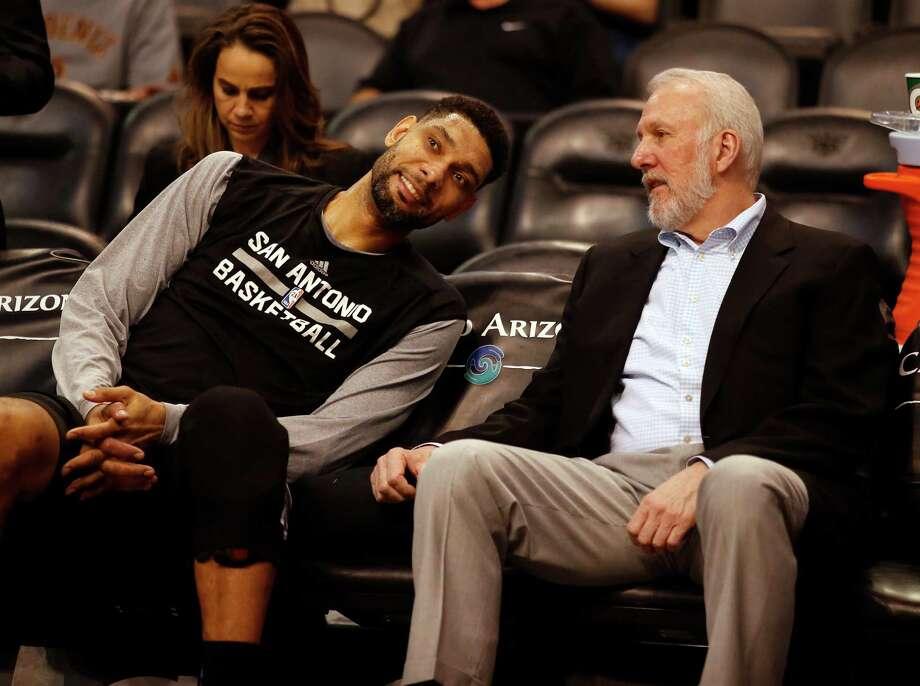 San Antonio Spurs forward Tim Duncan (21) and head coach Gregg Popovich in the first quarter during an NBA basketball game against the Phoenix Suns, Saturday, Feb. 28, 2015, in Phoenix. (AP Photo/Rick Scuteri) Photo: Rick Scuteri, Associated Press / FR157181 AP