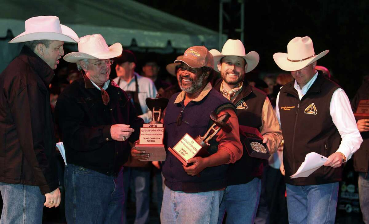 """""""Across the Track Cook-Off Team"""" is awarded the Grand Champion Overall winner for the 2015 Houston Livestock Show and Rodeo World's Champion Bar-B-Que Cookoff and representative Kerry Fellows receives the award on Saturday, Feb. 28, 2015, in Houston."""
