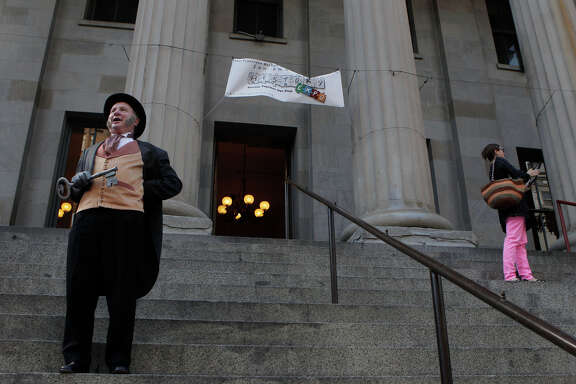Allan Shwartz, portraying Mayor Sutro, welcomes people to an event at the Old Mint last month. The city has ousted the group trying to turn it into a museum.
