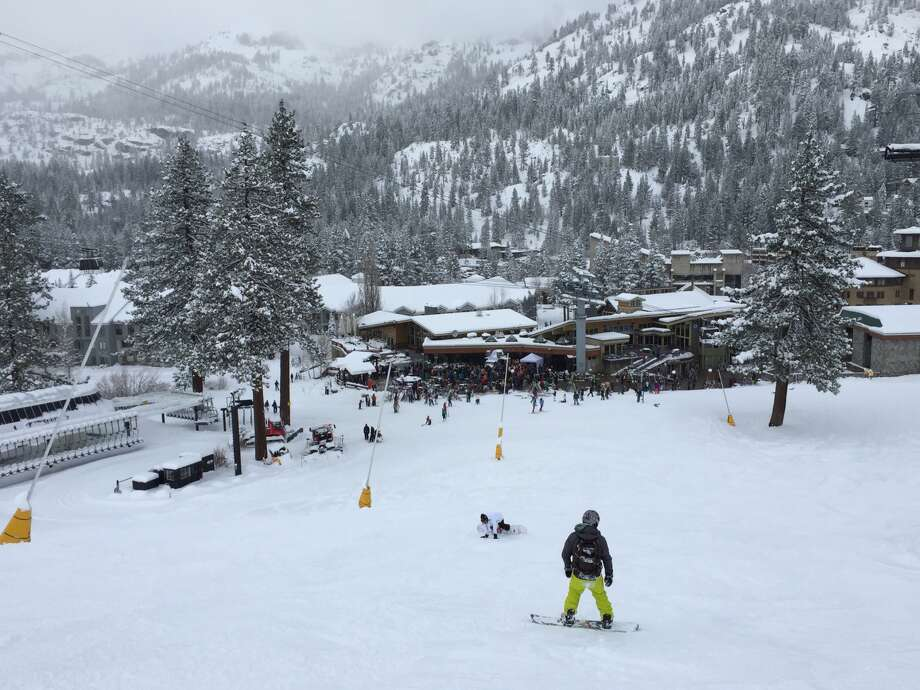 A snowboarder heads toward the village at Squaw Valley on Saturday. Photo: John Diaz, The Chronicle