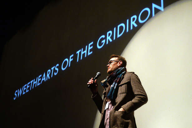 """Chip Hale, writer and director of documentary """"Sweethearts of the Gridiron,"""" takes questions after the movie's screening at the Jefferson Theater on Saturday. Saturday was the final day of the 8th annual Boomtown Film and Music Festival, and featured movies, music, and vendors at the Jefferson Theater, the Art Museum of Southeast Texas, and the Logon Cafe. Photo taken Saturday 2/28/15 Jake Daniels/The Enterprise"""