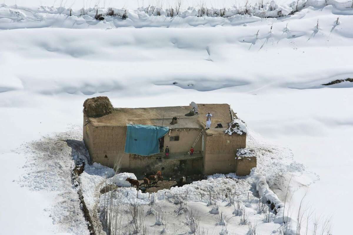 An Afghan family is seen at their home after an avalanche in the Paryan district of Panjshir province, north of Kabul, Afghanistan, Friday, Feb. 27, 2015. The death toll from severe weather that caused avalanches and flooding across much of Afghanistan has jumped to more than 200 people, and the number is expected to climb with cold weather and difficult conditions hampering rescue efforts, relief workers and U.N. officials said Friday.AP story: Afghan avalanche death toll rises amid rescue effort