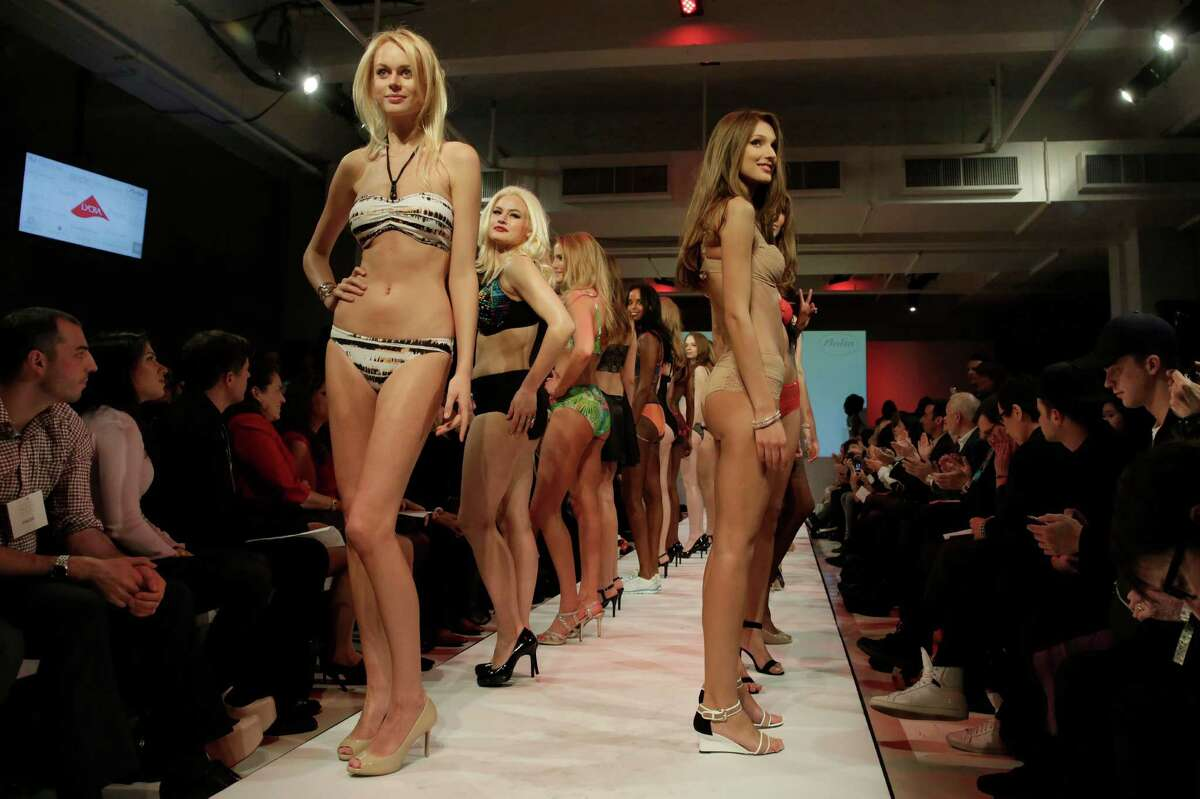 Models pose on the runway during the fianle of the 2015 CURVExpo and Invista sleepwear, loungewear and swim collections, during the 2nd annual Lingerie Fashion Night,
