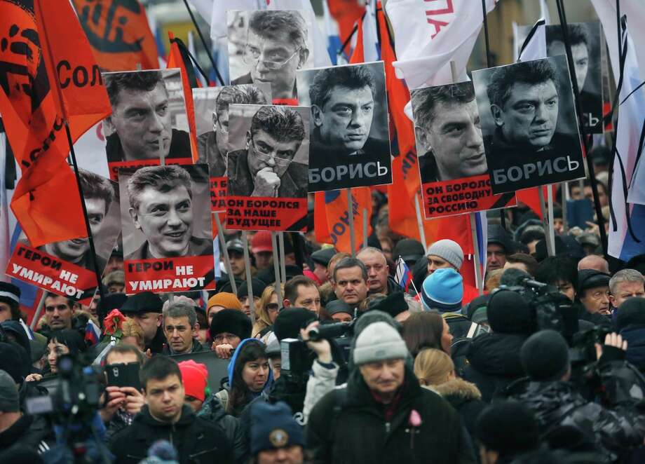 Thousands march near the Kremlin in memory of opposition leader Boris Nemtsov, who was gunned down Friday near Moscow's Red Square. Photo: Dmitry Lovetsky / Associated Press / AP
