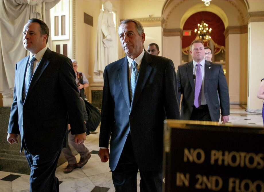 Speaker of the House John Boehner, R-Ohio, walks to the chamber as the House failed to advance a short-term funding measure to keep the Department of Homeland Security funded past a midnight deadline, at the Capitol in Washington, Friday evening, Feb. 27, 2015. Conservatives in Speaker Boehner's own party fought against three-week funding measure because it would not overturn Obama's actions on immigration.  (AP Photo/J. Scott Applewhite) Photo: J. Scott Applewhite / Associated Press / AP