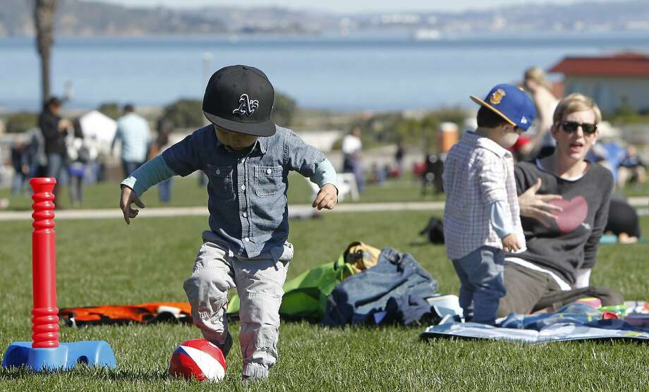 Noah Jang, 2, of San Francisco plays in the grass during an Off the Grid Picnic at the Presidio event earlier this year. Photo: Jessica Christian, The Chronicle