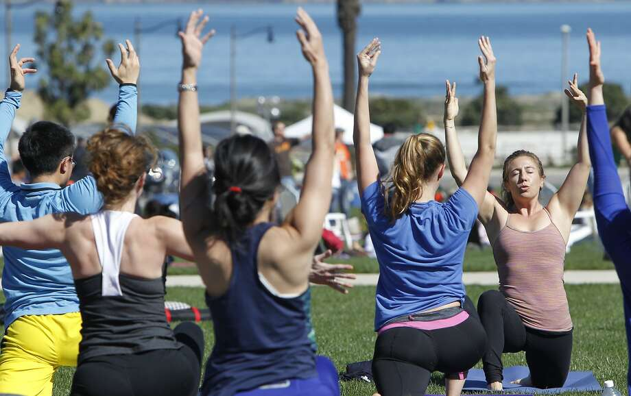 Leila Burrows of The Pad yoga studio in San Francisco instructs a yoga and pilates class during Off The Grid's Picnic at the Presidio event at the Presidio Main Post lawn in San Francisco, Calif. Sunday, March 1, 2015. Photo: Jessica Christian, The Chronicle