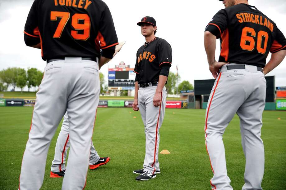 San Francisco Giants' Steven Okert (center) talks with Nik Turley (79) and Hunter Strickalnd (60) during Spring Training at Scottsdale Stadium in Scottsdale, Arizona, on Sunday, March 1, 2015. Photo: Scott Strazzante / The Chronicle / ONLINE_YES