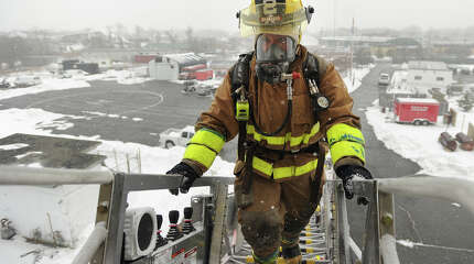 Volunteer firefighters from ten towns participate in the Valley Fire Chiefs Regional Training School's Firefighter 1 class at the Fairfield Regional Fire School facility in Fairfield, Conn. on Sunday, March 1, 2015.