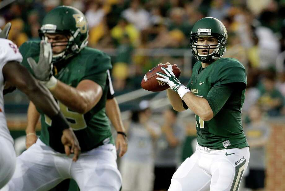 Baylor quarterback Seth Russell prepares to pass under protection of Troy Baker in the first half against Northwestern State on Sept. 6, 2014, in Waco. Photo: Tony Gutierrez /Associated Press / AP