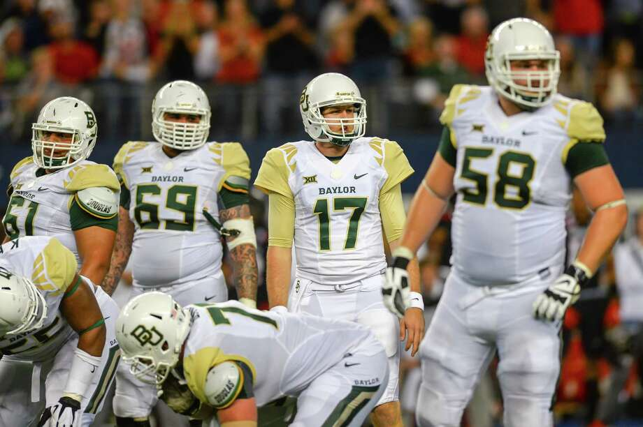 Seth Russell (17_ of the Baylor Bears look to the sideline for play against the Texas Tech Red Raiders on Nov. 29, 2014 at AT&T Stadium in Arlington. Baylor won 48-46. Photo: John Weast /Getty Images / 2014 Getty Images