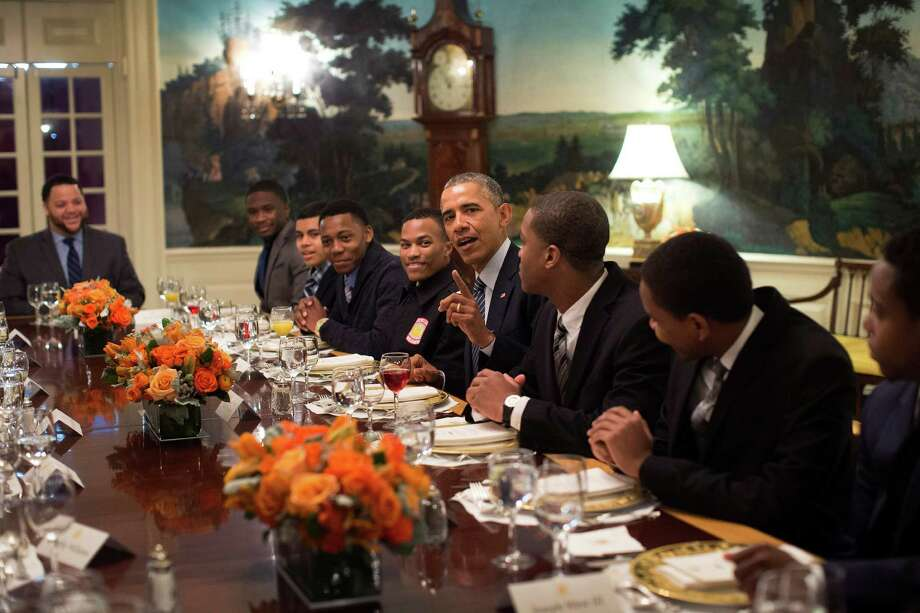 President Barack Obama lunches with participants in the My Brother's Keeper program, at the White House in Washington, Feb. 27, 2015. The initiative was first announced a year ago today at a speech in which Obama candidly drew on his own racial identity in a way he seldom has done in office. (Doug Mills/The New York Times) Photo: DOUG MILLS / New York Times / NYTNS