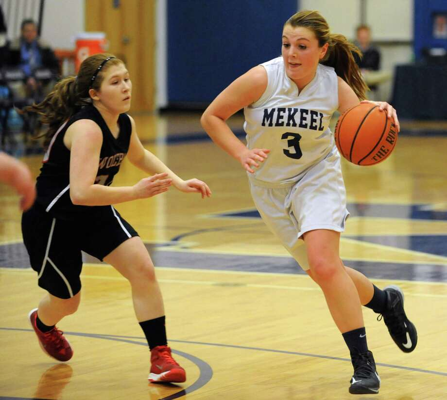 Mekeel Christian Academy's Nicole Pigliavento is guarded by OESJ's Abby Mosher as she drive to the hoop during a basketball game on Tuesday, Feb. 24, 2015 in Scotia, N.Y. (Lori Van Buren / Times Union) Photo: Lori Van Buren / 00030729A