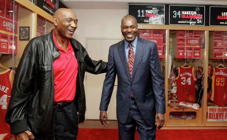 Elvin Hayes, left, and Hakeem Olajuwon, right, visit after a ceremony to unveil the Legends Lockers display on the Upper Concourse of the Toyota Center to honor eleven different Rockets franchise greats shown Sunday, March 1, 2015, in Houston. The Legends Lockers feature photos, memorabilia and artifacts of Leslie Alexander, Hakeem Olajuwon, Clyde Drexler, Rudy Tomjanovich, Yao Ming, Tracy McGrady, Elvin Hayes, Moses Malone, Ralph Sampson, Steve Francis and Calvin Murphy.
