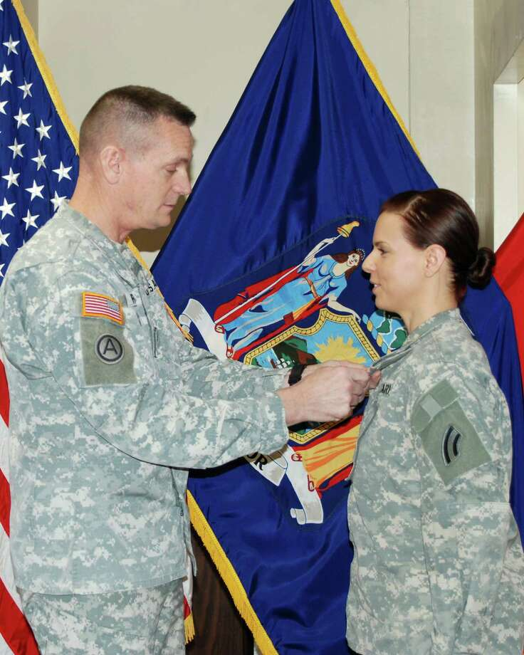 Division of Military and Naval Affairs Chief Warrant Officer 3 Heather Ruter receives a Meritorious Service Medal from Maj. Gen. Patrick Murphy, adjutant general of state military forces, during a ceremony at the state Division of Military and Naval Affairs Headquarters in Latham.