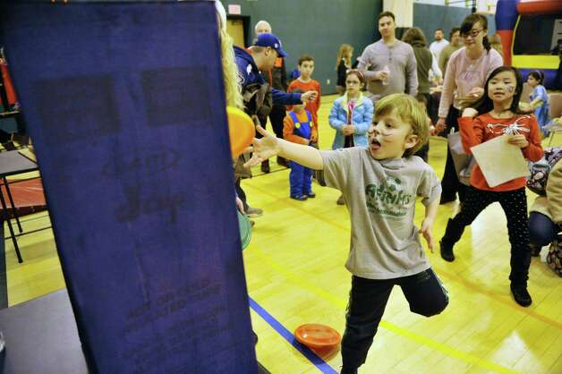 Jacob Angelou, 5, of Clifton Park tosses a frisbee during a game at the Purim Festival at the Schenectady JCC on Sunday, March 1, 2015, in Schenectady, N.Y.  The JCC, which has been in existence for 94 years, has been holding the yearly festival for almost all of its years.  The Purim holiday begins at sundown on this Wednesday, and the holiday commemorates the deliverance of the Jewish people in the ancient Persian Empire where a plot had been formed to destroy them.   (Paul Buckowski / Times Union) Photo: PAUL BUCKOWSKI / 00030667A