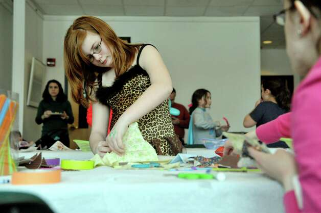 Erin Kipp, 11, of Guilderland makes a decorative hamantash in the arts and crafts room at the Purim Festival at the Schenectady JCC on Sunday, March 1, 2015, in Schenectady, N.Y.  Hamantash is a three-side cookie made for Jewish holidays.  The JCC, which has been in existence for 94 years, has been holding the yearly festival for almost all of its years.  The Purim holiday begins at sundown on this Wednesday, and the holiday commemorates the deliverance of the Jewish people in the ancient Persian Empire where a plot had been formed to destroy them.   (Paul Buckowski / Times Union) Photo: PAUL BUCKOWSKI / 00030667A
